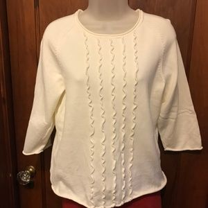 Cream color sweater with ruffle front, size L